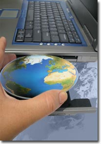 hand inserting the world into a computer photo